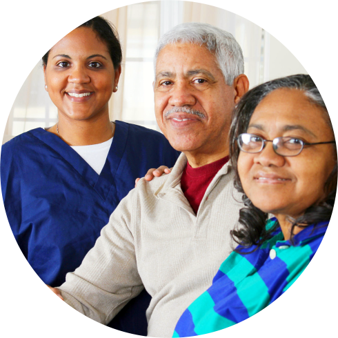 caregiver with patients smiling